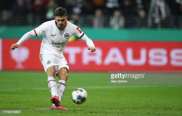 Andre Silva of Eintracht Frankfurt scores his team's first goal from the penalty spot during the DFB Cup quarterfinal match between Eintracht...