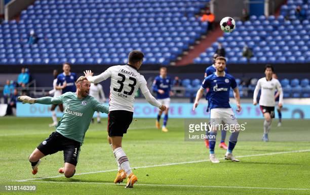 Andre Silva of Eintracht Frankfurt scores their side's first goal during the Bundesliga match between FC Schalke 04 and Eintracht Frankfurt at...