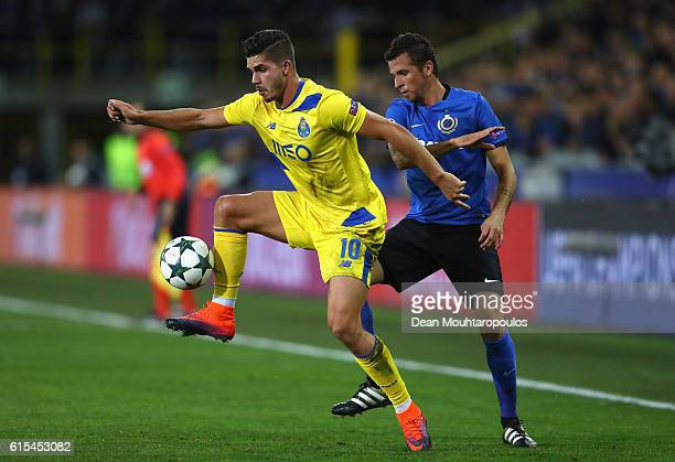 Andre Silva of FC Porto and Claudemir of Club Brugge compete for the ball during the UEFA Champions League Group G match between Club Brugge KV and...