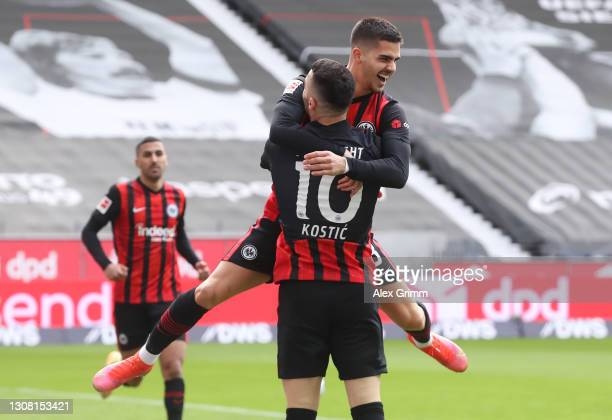Andre Silva of Frankfurt celebrates his team's first goal with teammate Filip Kostic during the Bundesliga match between Eintracht Frankfurt and 1....