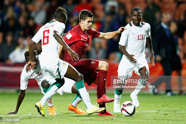 Andre Silva of Portugal and Elimane Cisse and Alhassane Sylla of Senegal battle for the ball during the FIFA U20 World Cup New Zealand 2015 Group C...