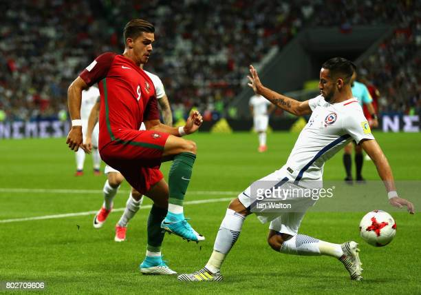 Andre Silva of Portugal and Mauricio Isla of Chile battle for possession during the FIFA Confederations Cup Russia 2017 SemiFinal between Portugal...