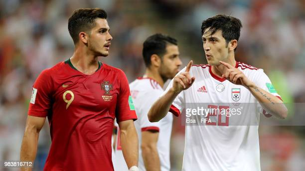Andre Silva of Portugal and Sardar Azmoun of Iran in conversation during the 2018 FIFA World Cup Russia group B match between Iran and Portugal at...