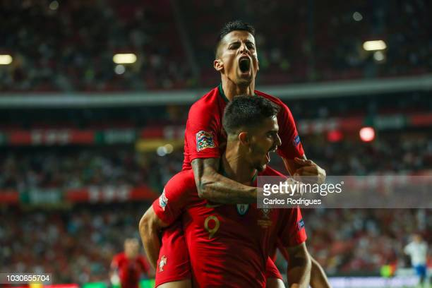 Andre Silva of Portugal and Sevilla celebrates scoring Portugal goal with Joao Cancelo of Portugal and Juventus during the UEFA Nations League A...