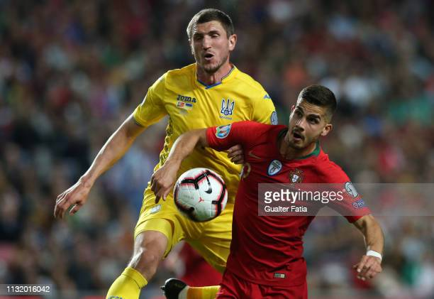 Andre Silva of Portugal and Sevilla FC with Sergii Kryvtsov of Ukraine in action during the UEFA Euro 2020 Qualifier match between Portugal and...