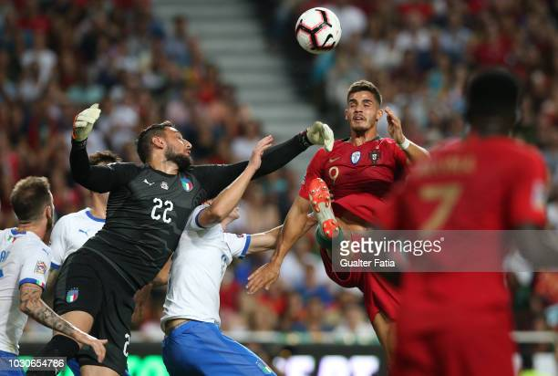 Andre Silva of Portugal and Sevilla with Gianluigi Donnarumma of Italy and AC Milan in action during the UEFA Nations League A Group 3 match between...