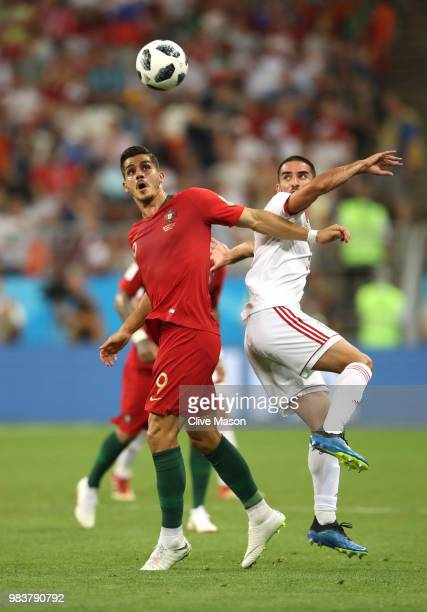 Andre Silva of Portugal battles for possession with Vahid Amiri of Iran during the 2018 FIFA World Cup Russia group B match between Iran and Portugal...