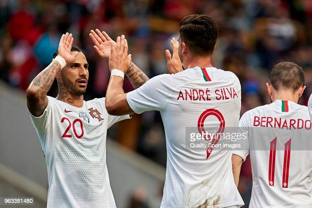 Andre Silva of Portugal celebrates with Ricardo Quaresma of Portugal after scoring his team's first goal during the friendly match of preparation for...