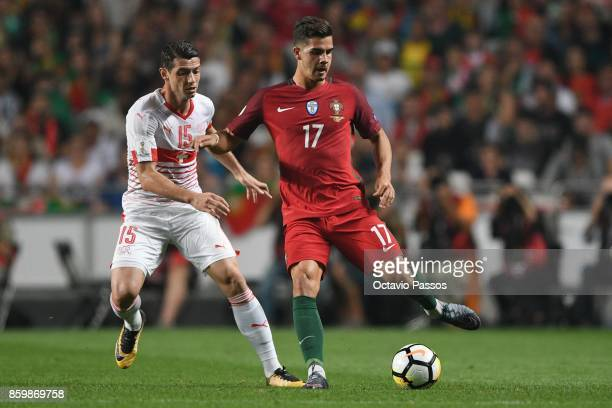 Andre Silva of Portugal competes for the ball with Blerim Dzemaili of Switzerland during the FIFA 2018 World Cup Qualifier between Portugal and...