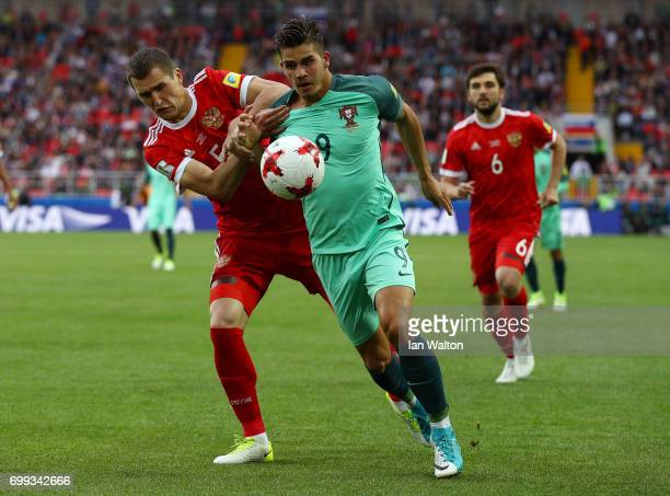 Andre Silva of Portugal controls the ball under pressure of Viktor Vasin of Russia during the FIFA Confederations Cup Russia 2017 Group A match...
