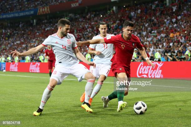Andre Silva of Portugal is challenged by Nacho of Spain and Lucas Vazquez of Spain during the 2018 FIFA World Cup Russia group B match between...