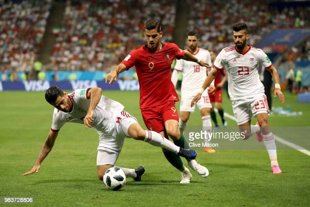 Andre Silva of Portugal is challenged by Ramin Rezaeian and Morteza Pouraliganji of Iran during the 2018 FIFA World Cup Russia group B match between...
