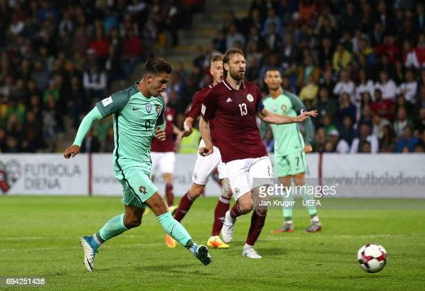 Andre Silva of Portugal scores his sides third goal during the FIFA 2018 World Cup Qualifier between Latvia and Portugal at Skonto Stadium on June 9...