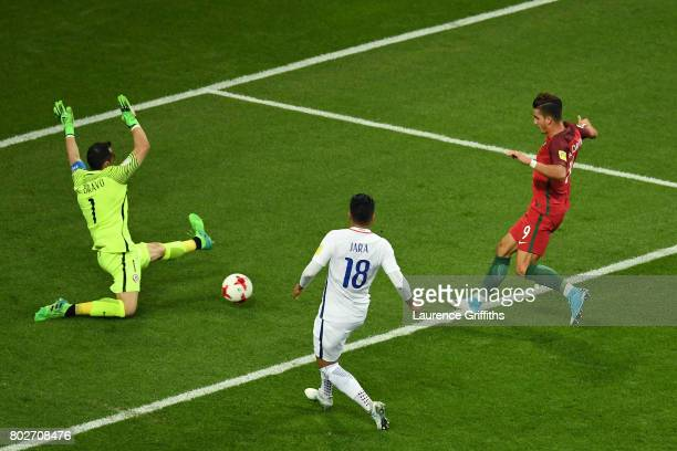 Andre Silva of Portugal shoots as Claudio Bravo of Chile saves during the FIFA Confederations Cup Russia 2017 SemiFinal between Portugal and Chile at...