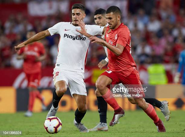 Andre Silva of Sevilla competes for the ball with Daniel Ceballos of Real Madrid during the La Liga match between Sevilla FC and Real Madrid CF at...