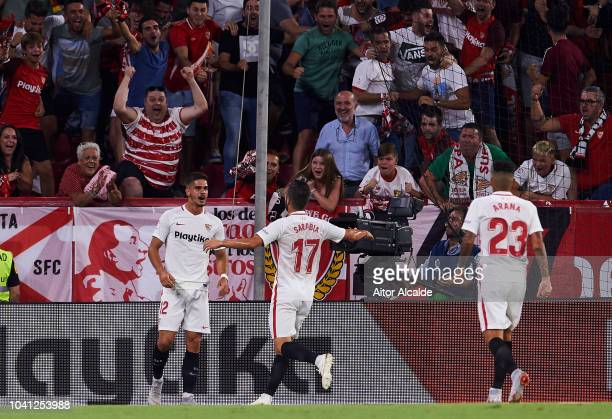 Andre Silva of Sevilla FC celebrates after scoring his team's second goal during the La Liga match between Sevilla FC and Real Madrid CF at Estadio...