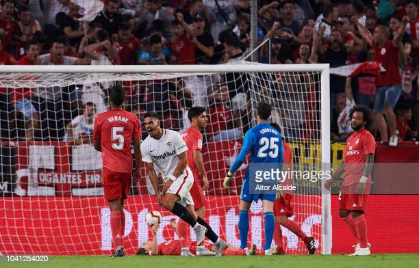 Andre Silva of Sevilla FC celebrates after scoring his team's second goal during the La Liga match between Sevilla FC and Real Madrid CF at Estadio...