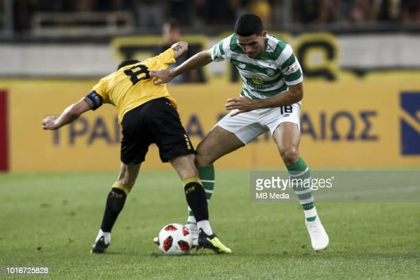 Andre Simoes of AEK Athens and Tom Rogic of Celtic battle for the ball during the UEFA Champions League Qualifying Third Round 2nd Leg match between...