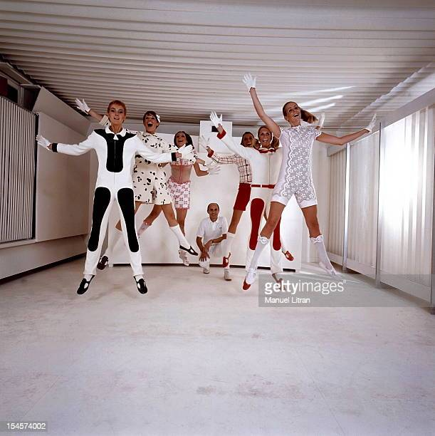 Andre smiling attitude of crouching behind his models COURREGES leaping into the air dressed in the designer's new creations