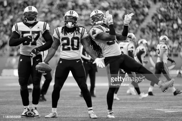 Andre Smith Jordan Scarlett and Tre Boston of Carolina Panthers celebrate after an interception by Jordan Scarlett during the NFL game between...