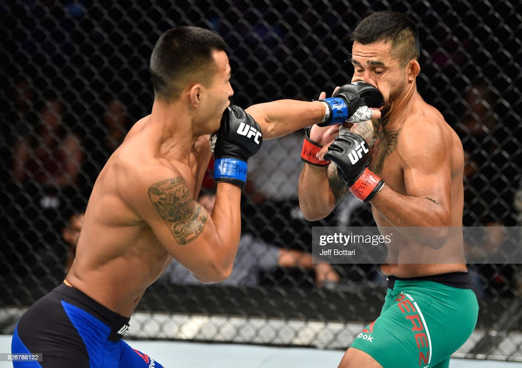 Andre Soukhamthath punches Alejandro Perez of Mexico in their bantamweight bout during the UFC Fight Night event at Arena Ciudad de Mexico on August 5, 2017 in Mexico City, Mexico.