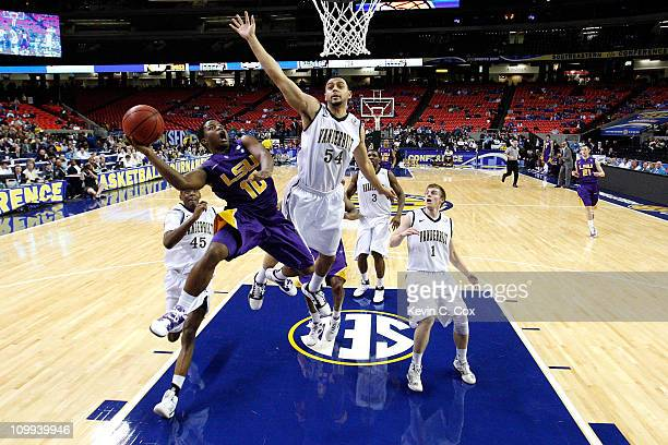 Andre Stringer of the LSU Tigers shoots against Andre Walker of the Vanderbilt Commodores during the first round of the SEC Men's Basketball...