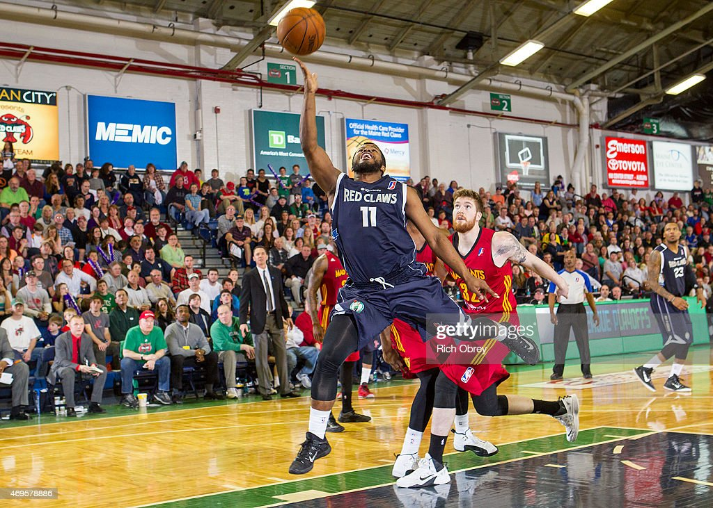 Andre Stringer #11 of the Maine Red Claws drives to the basket against Shayne Whittington #32 of the Fort Wayne Mad Ants during Playoff Game #2 on April 11, 2015 at the Portland Expo.