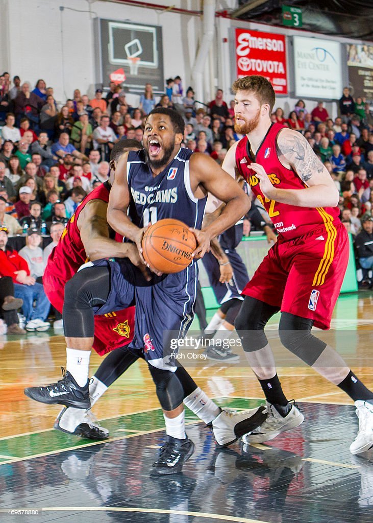Andre Stringer #11 of the Maine Red Claws gets open in the paint against Shayne Whittington #32 of the Fort Wayne Mad Ants during Playoff Game #2 on April 11, 2015 at the Portland Expo.
