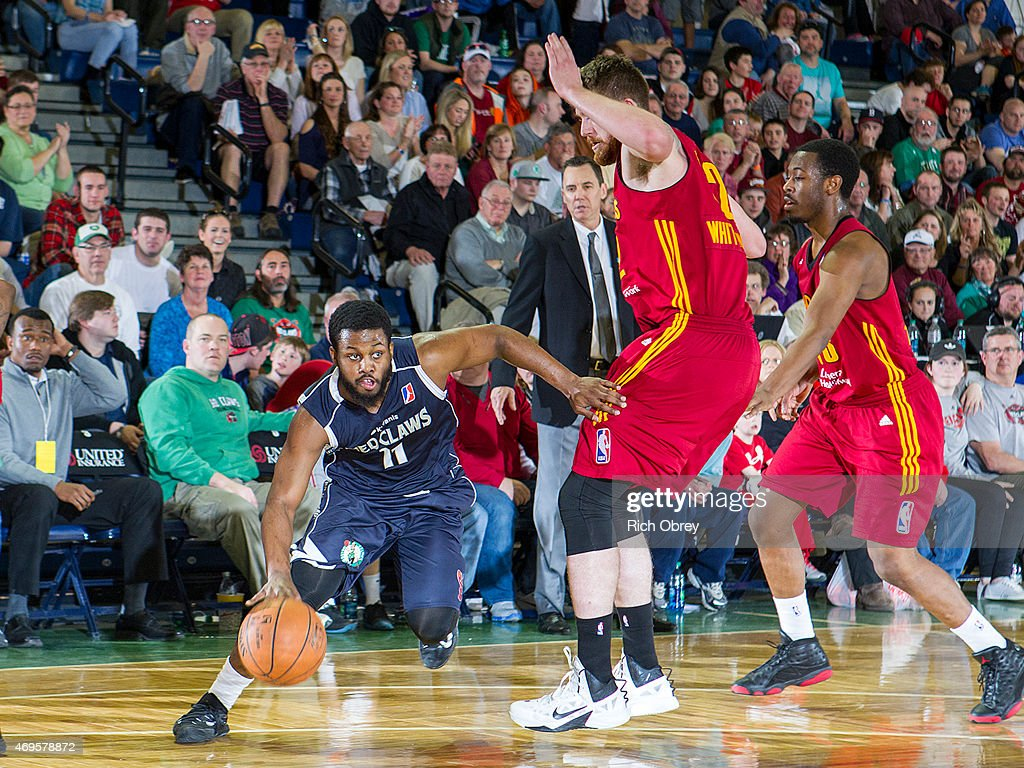 Andre Stringer #11 of the Maine Red Claws handles the ball against Shayne Whittington #32 of the Fort Wayne Mad Ants during Playoff Game #2 on April 11, 2015 at the Portland Expo.
