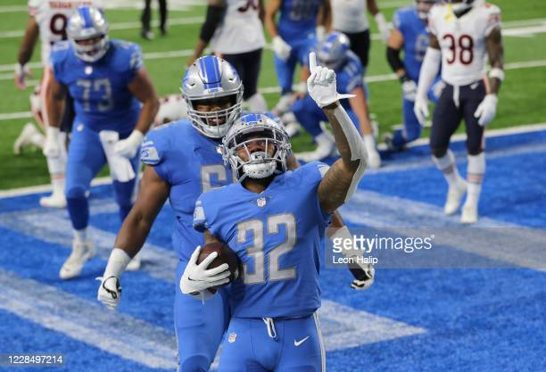 Andre Swift of the Detroit Lions celebrates a second quarter touchdown against the Chicago Bears at Ford Field on September 13, 2020 in Detroit,...