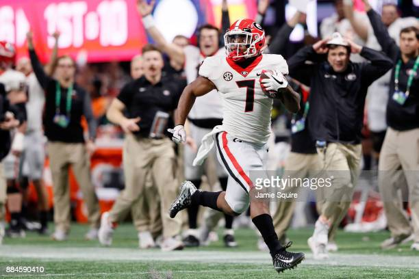 Andre Swift of the Georgia Bulldogs breaks away for a long touchdown run during the second half against the Auburn Tigers in the SEC Championship at...