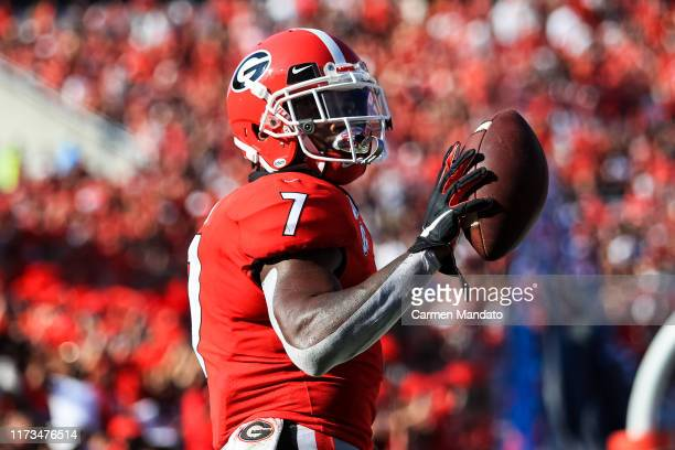 Andre Swift of the Georgia Bulldogs reacts following rushing for a touchdown during the game against the Murray State Racers at Sanford Stadium on...