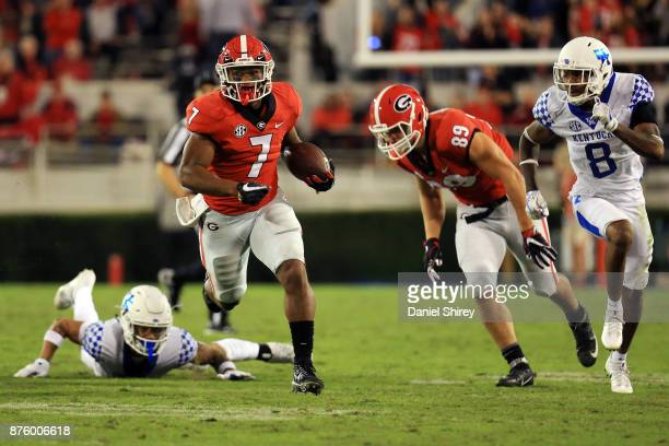 Andre Swift of the Georgia Bulldogs runs the ball during the second half against the Kentucky Wildcats at Sanford Stadium on November 18 2017 in...