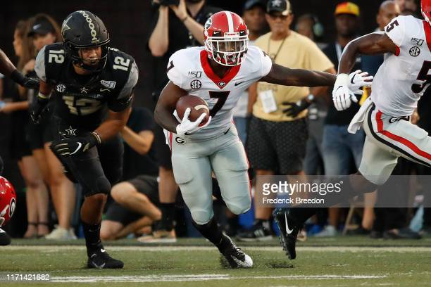 Andre Swift of the Georgia Bulldogs rushes against the Vanderbilt Commodores during the first half at Vanderbilt Stadium on August 31 2019 in...