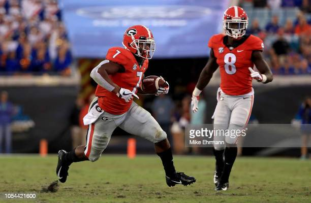 Andre Swift of the Georgia Bulldogs rushes during a game against the Florida Gators at TIAA Bank Field on October 27 2018 in Jacksonville Florida