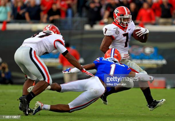 Andre Swift of the Georgia Bulldogs rushes during a game against the Florida Gators on November 02 2019 in Jacksonville Florida