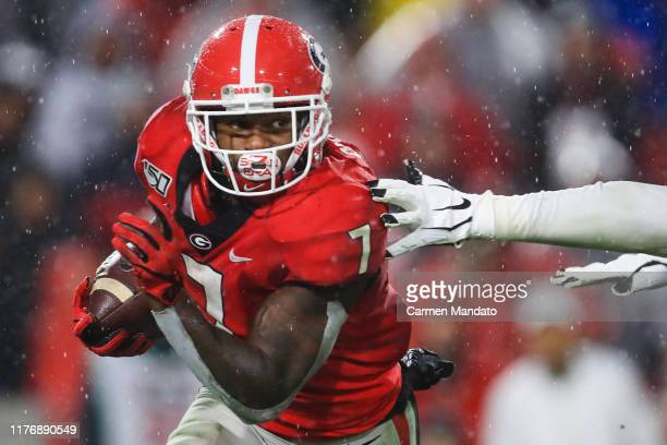 Andre Swift of the Georgia Bulldogs rushes during the first half of a game against the Kentucky Wildcats at Sanford Stadium on October 19 2019 in...
