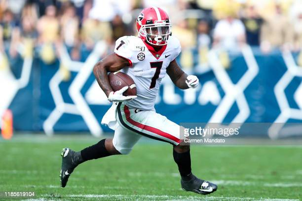 Andre Swift of the Georgia Bulldogs rushes during the first half of the game against the Georgia Tech Yellow Jackets at Bobby Dodd Stadium on...