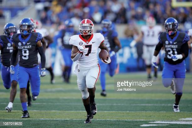 Andre Swift of the Georgia Bulldogs rushes for an 83yard touchdown in the third quarter of the game against the Kentucky Wildcats at Kroger Field on...
