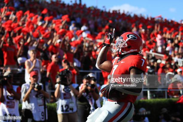 Andre Swift of the Georgia Bulldogs rushes ten yards for a touch down against the Murray State Racers during the first half at Sanford Stadium on...