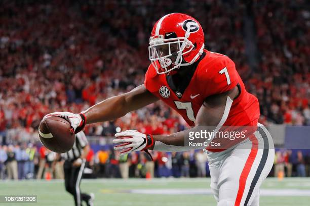 Andre Swift of the Georgia Bulldogs scores an 11yard receiving touchdown in the second quarter against the Alabama Crimson Tide during the 2018 SEC...
