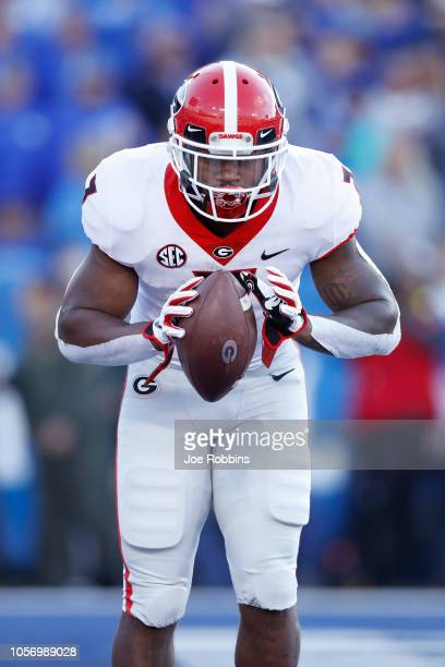Andre Swift of the Georgia Bulldogs takes a bow after rushing for a 20yard touchdown in the second quarter of the game against the Kentucky Wildcats...