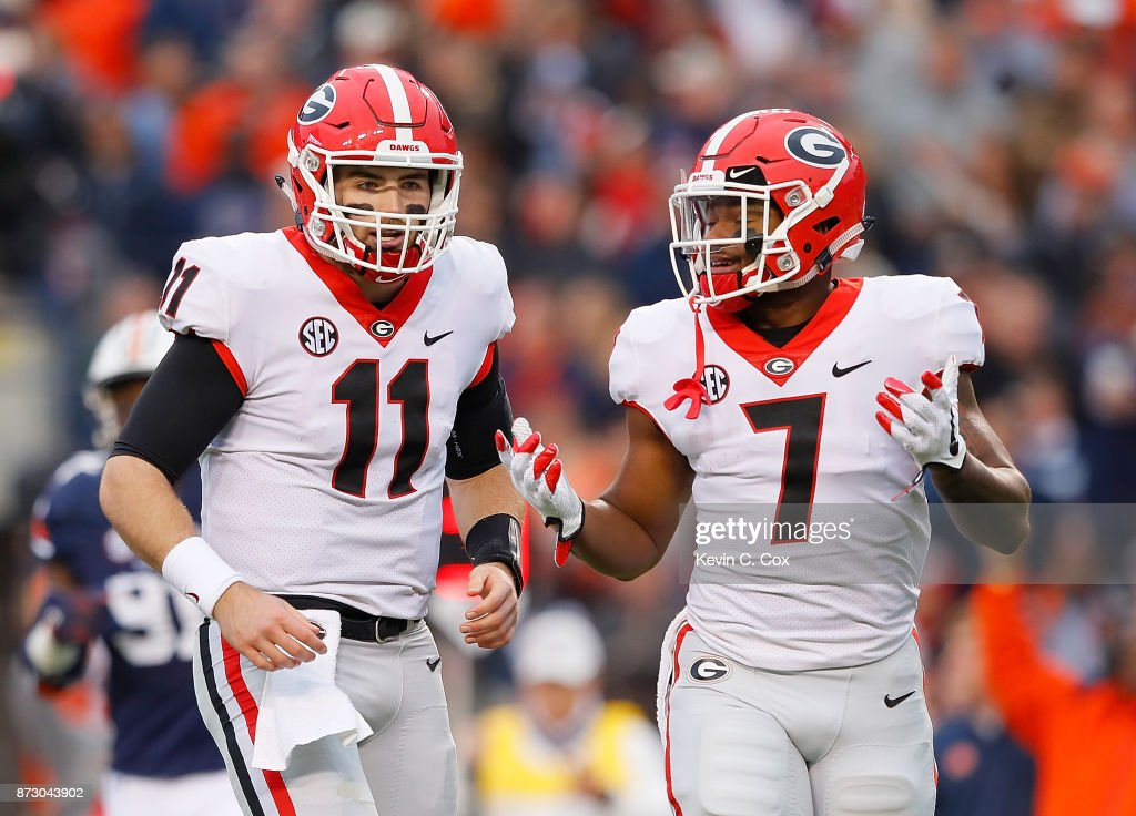 D'Andre Swift #7 reacts with Jake Fromm #11 of the Georgia Bulldogs after an incomplete pass against the Auburn Tigers at Jordan Hare Stadium on November 11, 2017 in Auburn, Alabama.
