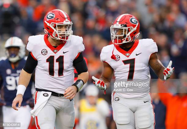 Andre Swift reacts with Jake Fromm of the Georgia Bulldogs after an incomplete pass against the Auburn Tigers at Jordan Hare Stadium on November 11...