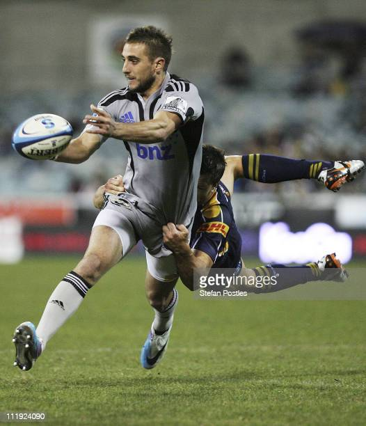 Andre Taylor of the Hurricanes passes the ball during the round eight Super Rugby match between the Brumbies and the Hurricanes at Canberra Stadium...