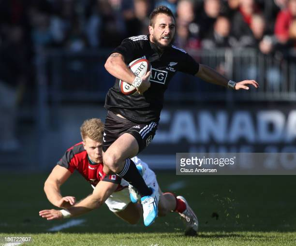 Andre Taylor of the New Zealand Maori All Blacks breaks a tackle against Team Canada during the AIG Canada friendly game at BMO Field on November 3,...