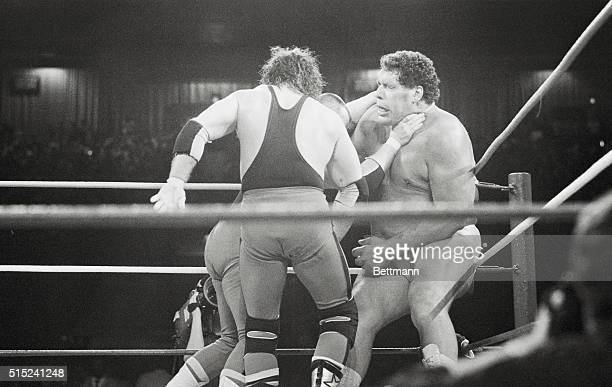 Andre the Giant has a choke hold applied to him by one of several opponents during 20an Battle Royale match of Wrestlemania