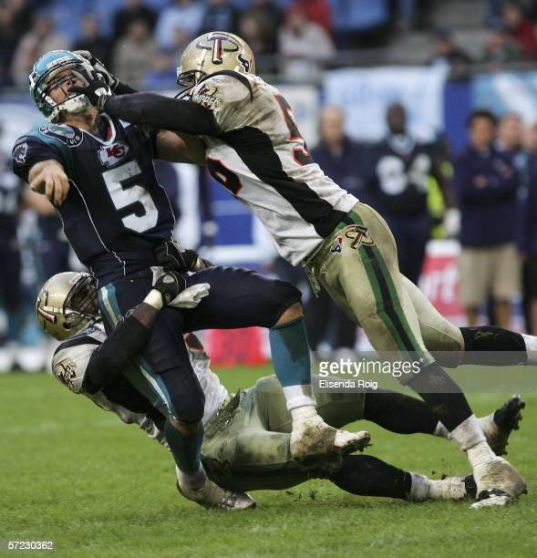 Andre Torrey and Quentin Swain of Berlin attack James Kilian of Devils during the NFL Europe match between Hamburg Sea Devils and Berlin Thunder at...