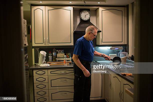 Andre van Krieken a 69yearold employed via specialist seniors recruitment company 65plus prepares his breakfast before going to work on the Spoorzone...