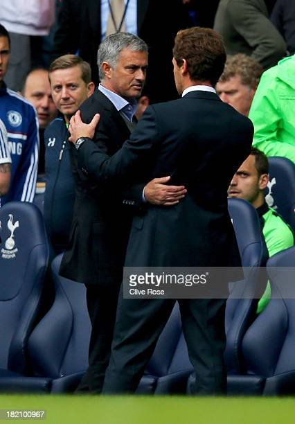 Andre VillasBoas manager of Tottenham Hotspur shakes hands with Jose Mourinho manager of Chelsea after the Barclays Premier League match between...